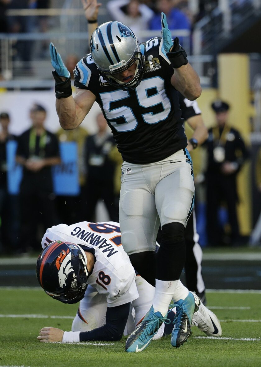 Carolina Panthers' Luke Kuechly, top, celebrates after sacking Denver Broncos' Peyton Manning during the first half of the NFL Super Bowl 50 football game Sunday, Feb. 7, 2016, in Santa Clara, Calif. (AP Photo/Julio Cortez)
