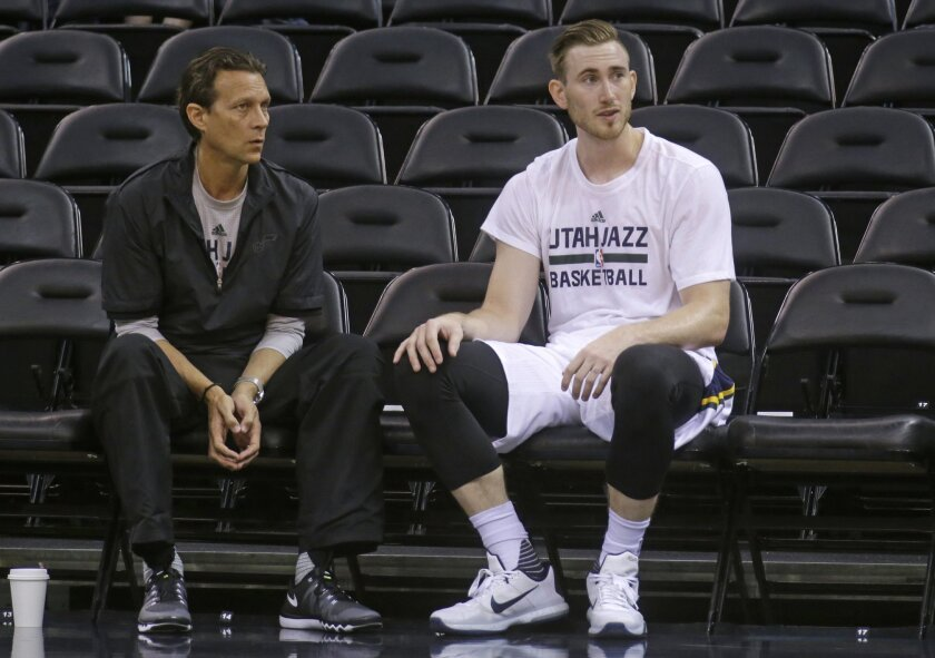 FILE - This Oct. 22, 2015, file photo, shows Utah Jazz head coach Quin Snyder and Utah Jazz guard Gordon Hayward, right, talking during practice before the start of their NBA preseason basketball game against Denver Nuggets, in Salt Lake City. Hayward is off to a slow start in a year he expected to