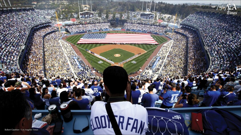 A fan looks on during the pregame ceremony at Dodger Stadium.