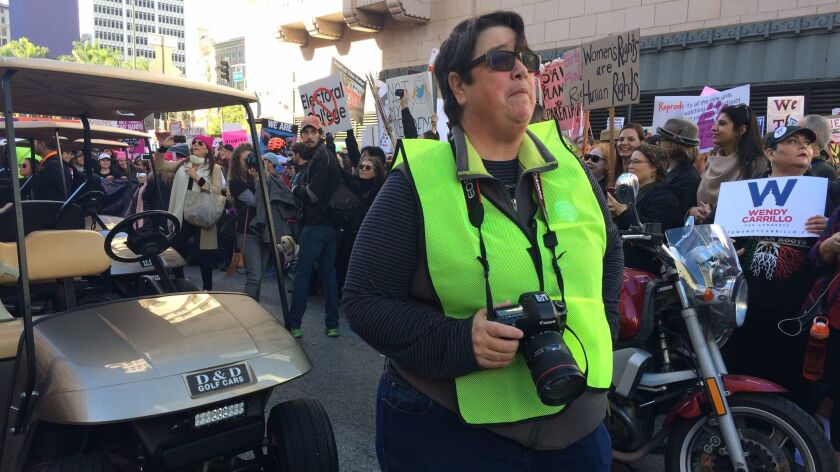 Artist Catherine Opie waits for the Women's March to kick off in downtown Los Angeles.