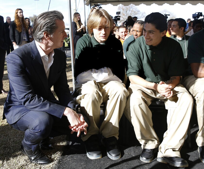 Governor Gavin Newsom talks with young men at a youth correctional facility