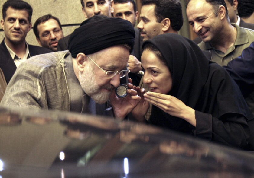 FILE - In this July 13, 2005, file photo, outgoing reformist Iranian President Mohammad Khatami talks on the phone with the mother of female journalist Masih Alinejad, right, after meeting with journalists in Tehran, Iran. Prosecutors in the U.S. alleged Tuesday, July 13, 2021, that Iran planned to kidnap Alinejad, famous for her campaign against the Islamic Republic's mandatory headscarf, or hijab, for women. Iran did not immediately comment on the allegation Wednesday, July 14, 2021. (AP Photo/Hasan Sarbakhshian, File)