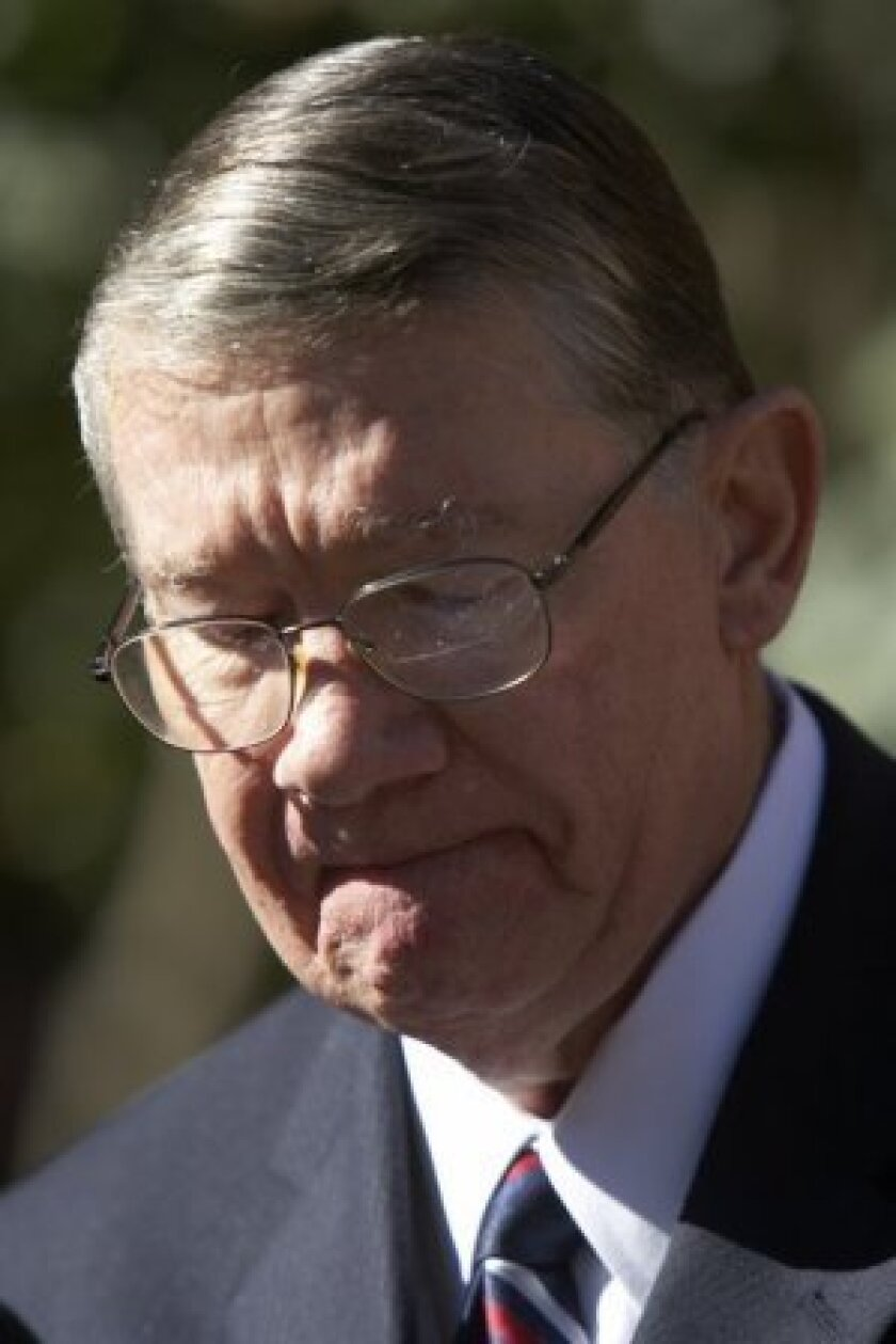 """Randy """"Duke"""" Cunningham speaks to reporters after pleading guilty in 2005."""