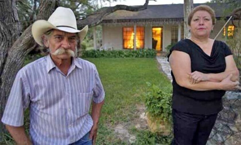 "FAMILY HEIRLOOM: Eddie and Gloria Garza's two-acre lot ""has a sentimental value that is worth more than any amount of money,"" Gloria says."