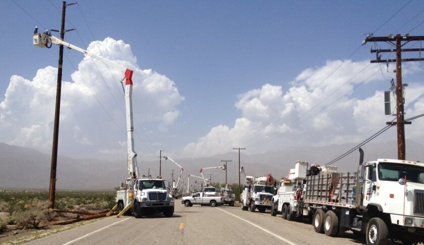 SDG&E crews work to restore power to Borrego Springs residents after intense thunderstorms cut electricity service to the area.
