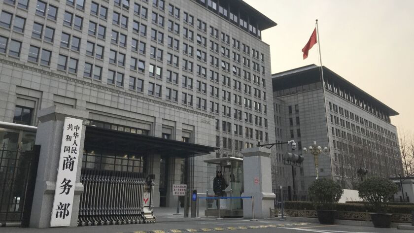 A Chinese paramilitary policeman stands guard at the main entrance gate of the Ministry of Commerce