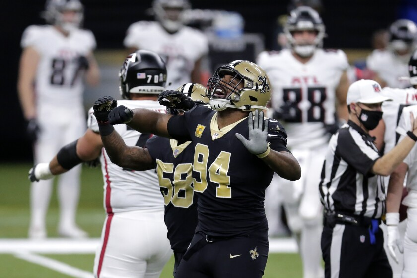 New Orleans Saints defensive end Cameron Jordan (94) celebrates his sack in the first half of an NFL football game against the Atlanta Falcons in New Orleans, Sunday, Nov. 22, 2020. (AP Photo/Brett Duke)