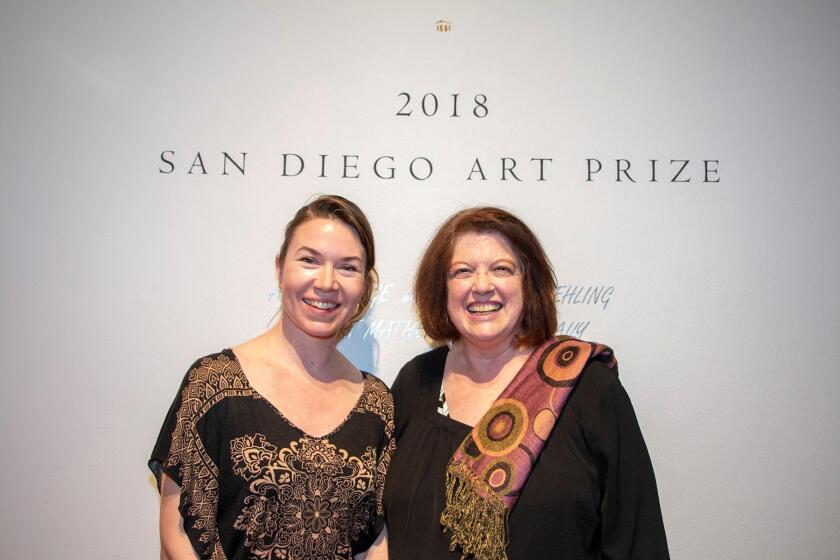 Chi Essary with Patricia Frischer handing over the Art Prize to the next generation
