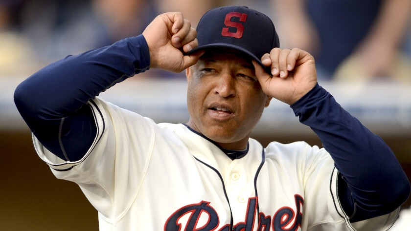 Dave Roberts played in the majors for 10 seasons before becoming a broadcast analyst for NESN and then a coach with the Padres.