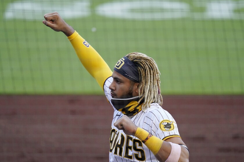 San Diego Padres shortstop Fernando Tatis Jr. reacts in the dugout after a home run by teammate Jake Cronenworth during the second inning of a baseball game against the Arizona Diamondbacks, Friday, Aug. 7, 2020, in San Diego. (AP Photo/Gregory Bull)