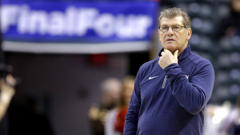 Connecticut Coach Geno Auriemma watches his team's pracatice on Saturday in Indianapolis.