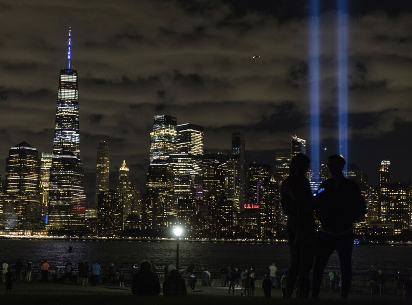 Tribute in Light, two vertical columns of light representing the fallen towers of the World Trade Center shine against the lower Manhattan skyline on the 19th anniversary of the Sept. 11, 2001 terror attacks, seen from Jersey City, N.J., on Friday, Sept. 11, 2020. (AP Photo/Stefan Jeremiah)