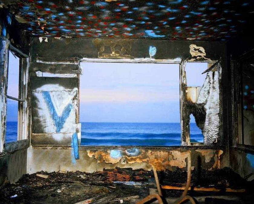 Art review: John Divola's photographs are challenging and astute. But a divided retrospective makes viewing difficult.