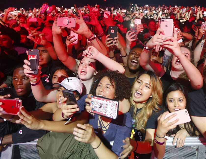 Fans take photos as Chance the Rapper performs at the Valley View Casino Center in San Diego on Monday, April 24, 2017. (Photo by K.C. Alfred/The San Diego Union-Tribune)