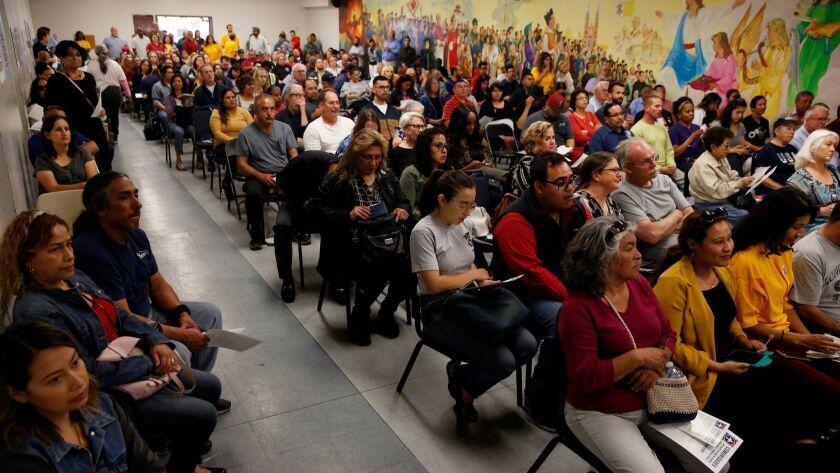 SAN BERNARDINO, CA-APRIL 17, 2019: Hundreds of San Bernardino residents sit in a town hall meeting