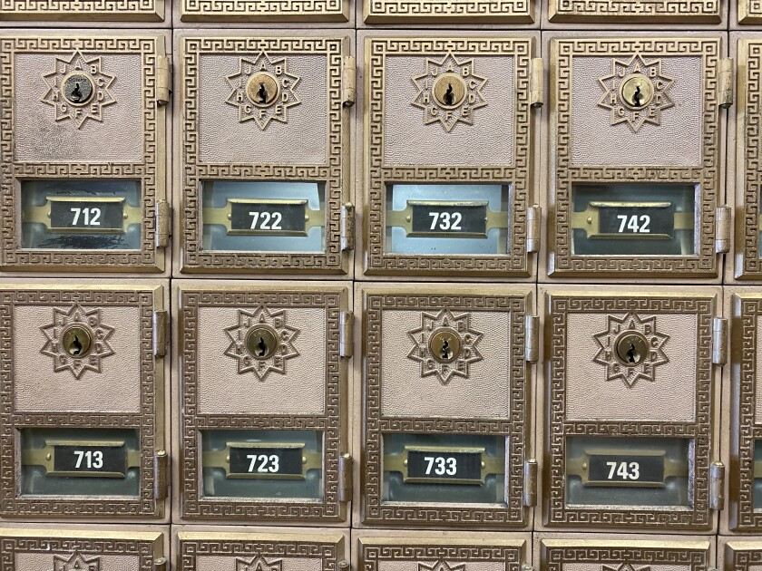 Post boxes remain popular in the Leadville, Colo., post office, where patrons gather to exchange wisdom and gossip.