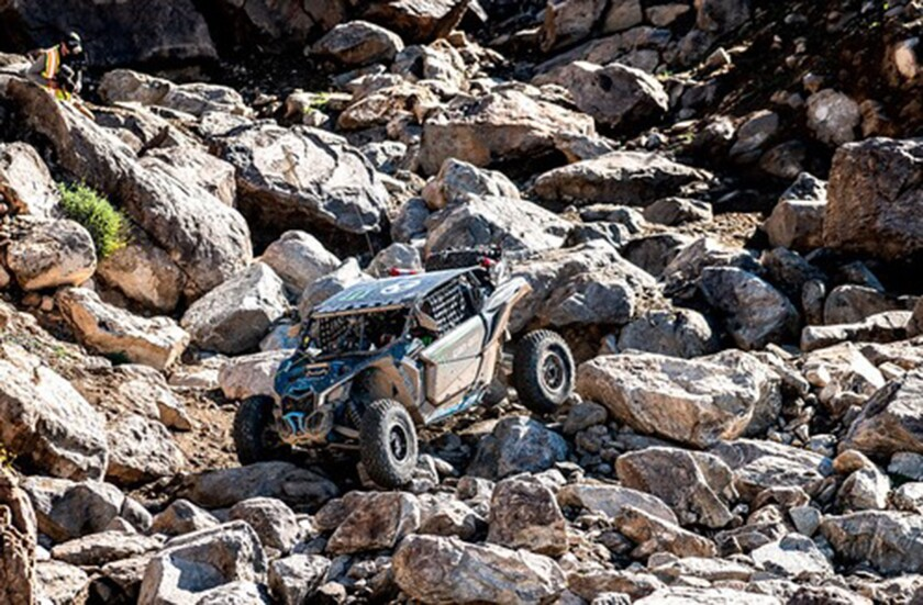 A souped-up car navigates big rocks