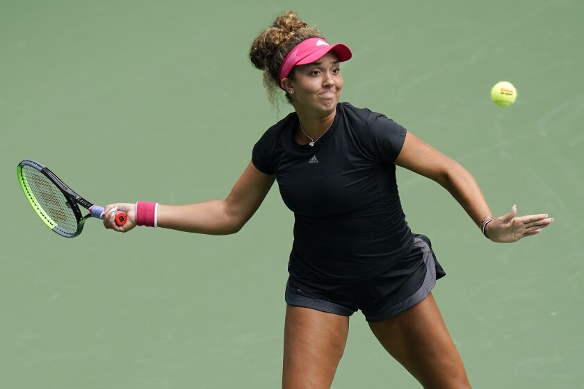 Katrina Scott returns a shot to Amanda Anisimova during the second round of the US Open on Sept. 3 in New York.