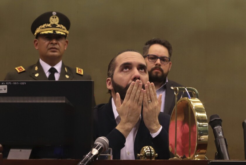 President Nayib Bukele with his hands open in front of his face and his eyes cast upward