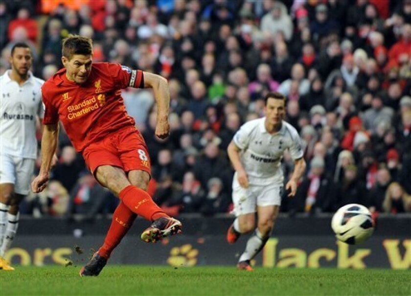 Liverpool's Steven Gerrard scores the third and winning goal of the game for his side from the penalty spot during their English Premier League soccer match against Tottenham Hotspur at Anfield in Liverpool, England, Sunday March 10, 2013. (AP Photo/Clint Hughes)