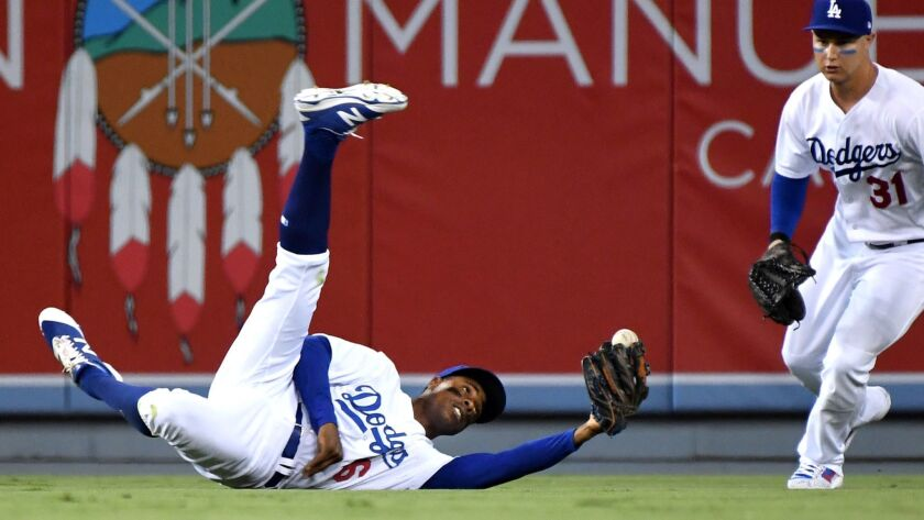 LOS ANGELES, CALIFORNIA SEPTEMBER 6, 2017-Dodgers Curtis Granderson makes a diving catch off the bat