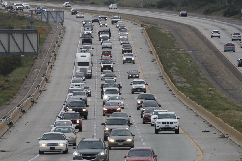 San Diego, CA.-March 14, 2016: Morning commute traffic out of Santee on Highway 52 can be trying, westbound in the morning, as in these photos, and eastbound on the afternoon commute.  JOHN GIBBINS / San Diego Union-Tribune)