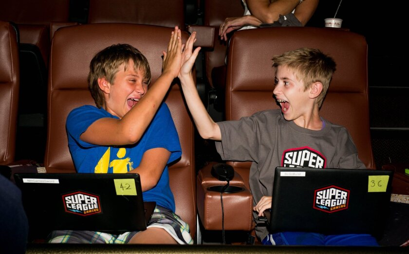 This Wednesday, Sept. 16, 2015 photo provided by Super League Gaming shows gamers attending the first in-theater video game league for multi-players of all ages to compete in the Super League Gaming event held at Cinemark Playa Vista and XD Theater in Los Angeles. (Super League Gaming via AP)