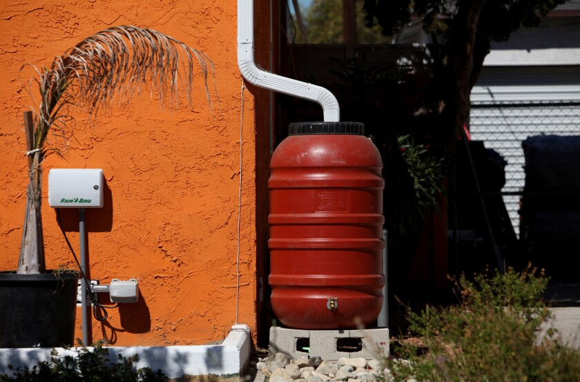 A rain barrell sits on the side of a home on a block on Elmer Avenue in Sun Valley.