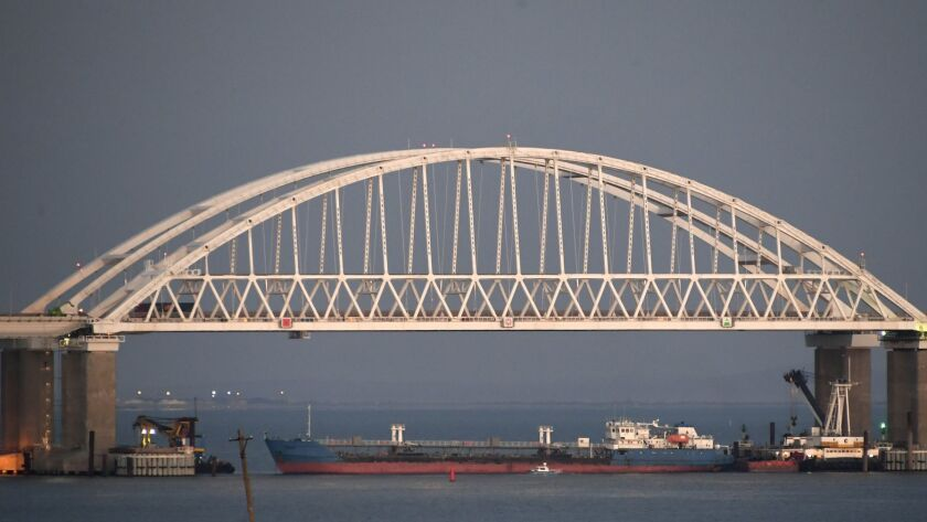 A ship under the the Kerch bridge blocks the passage to the Kerch Strait near Kerch, Crimea, Sunday,