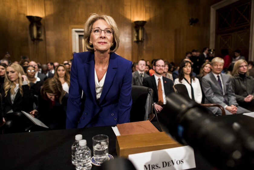 President Donald Trump's nominee for secretary of education, Betsy DeVos, appears before the Senate Health, Education, Labor and Pensions Committee on Jan. 17, 2017.