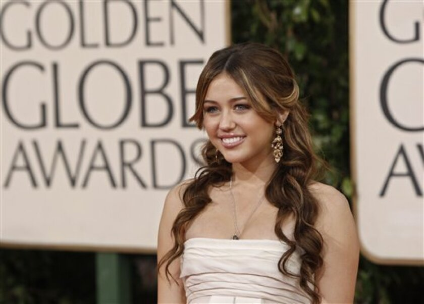 Miley Cyrus arrives at the 66th Annual Golden Globe Awards on Sunday, Jan. 11, 2009, in Beverly Hills, Calif. (AP Photo/Matt Sayles)