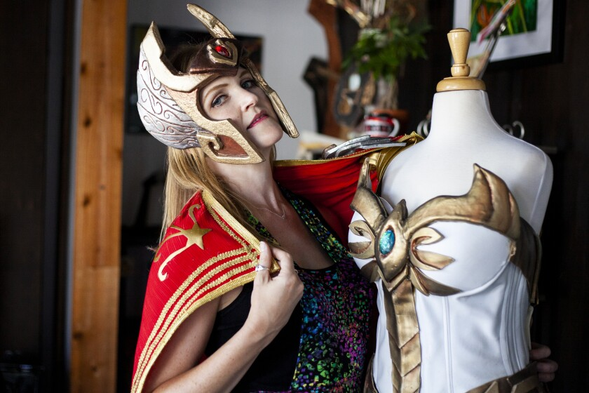 Renetta Lloyd poses with her cosplay creations at the Backfence Society, in Vista , CA