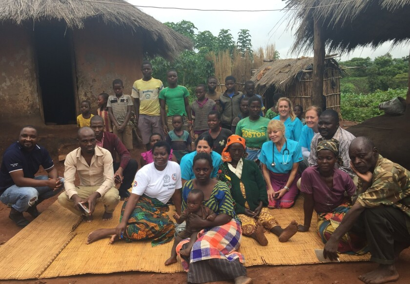 A team from Hospice of the North Coast traveled to Malawi Africa as part of its Global Partnership with Nkhoma Hospital in MalawiThe four-member team is pictured with  community members from Mala