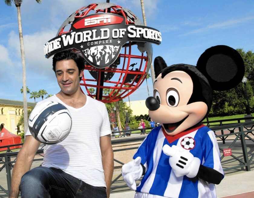 Actor Gilles Marini plays with Mickey Mouse at ESPN Wide World of Sports at Walt Disney World in Florida in 2013.