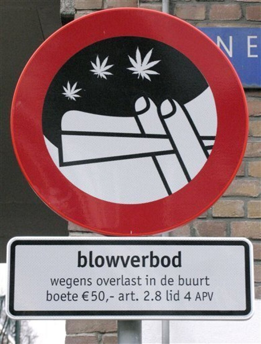 "FILE - In this Feb. 3, 2006 file photo a sign prohibiting the smoking of marijuana on the street is seen in Amsterdam, Netherlands. The Dutch government's top legal advisor has stubbed out so-called ""no toking zones"" in Amsterdam aimed at reining in public nuisance caused by dope-smoking youths. The Council of State says that Amsterdam municipality cannot outlaw marijuana smoking in certain parts of the city because doing so duplicates existing nationwide bans on possession of marijuana. (AP Photo/Peter Dejong, File)"