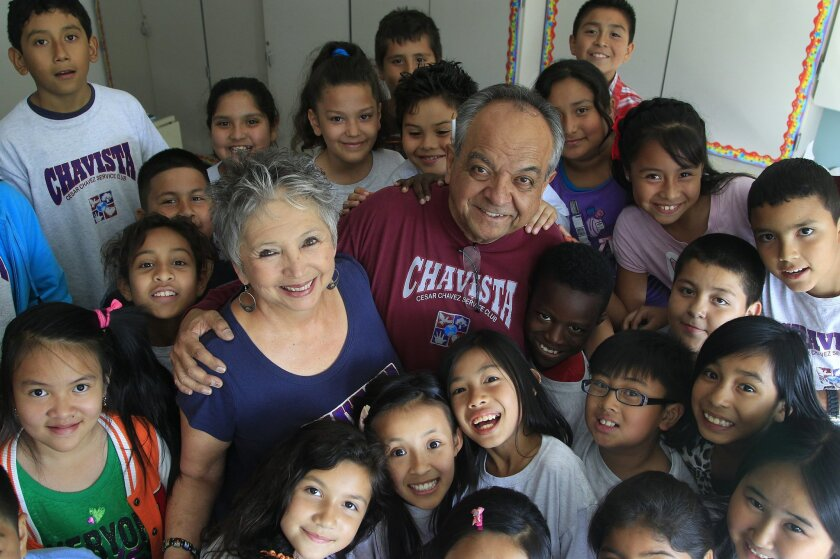 Linda and Carlos LeGerrette (center) get a group hug from students in the Cesar Chavez Service Club at San Diego's Central Elementary.