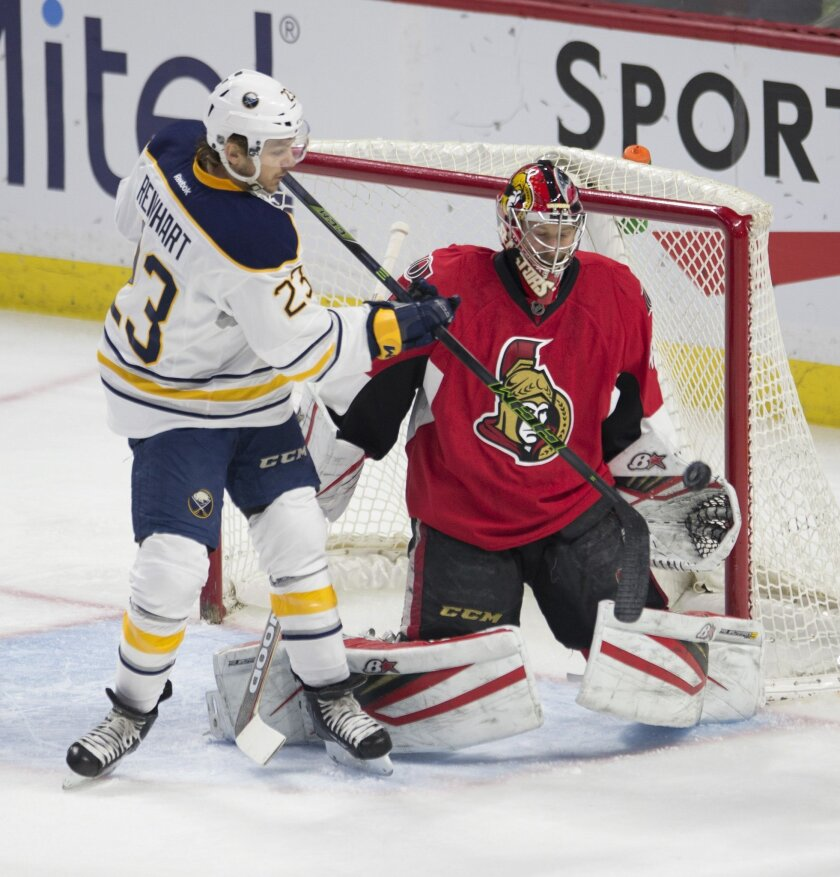 Buffalo Sabres' center Sam Reinhart (23) tries to deflect a shot past Ottawa Senators' goalie Craig Anderson during the first period of an NHL hockey game, Tuesday, Feb. 16, 2016 in Ottawa, Ontario.  (Adrian Wyld/The Canadian Press via AP) MANDATORY CREDIT