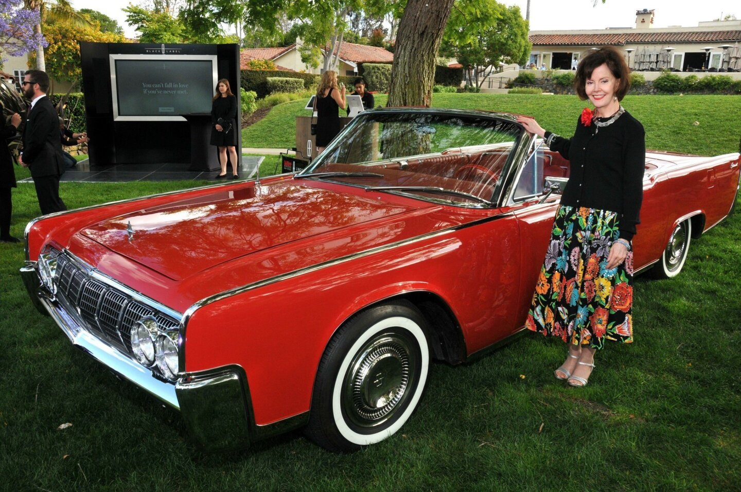 Laurel McCrink with Ed Witt's restored 1964 Lincoln Continental