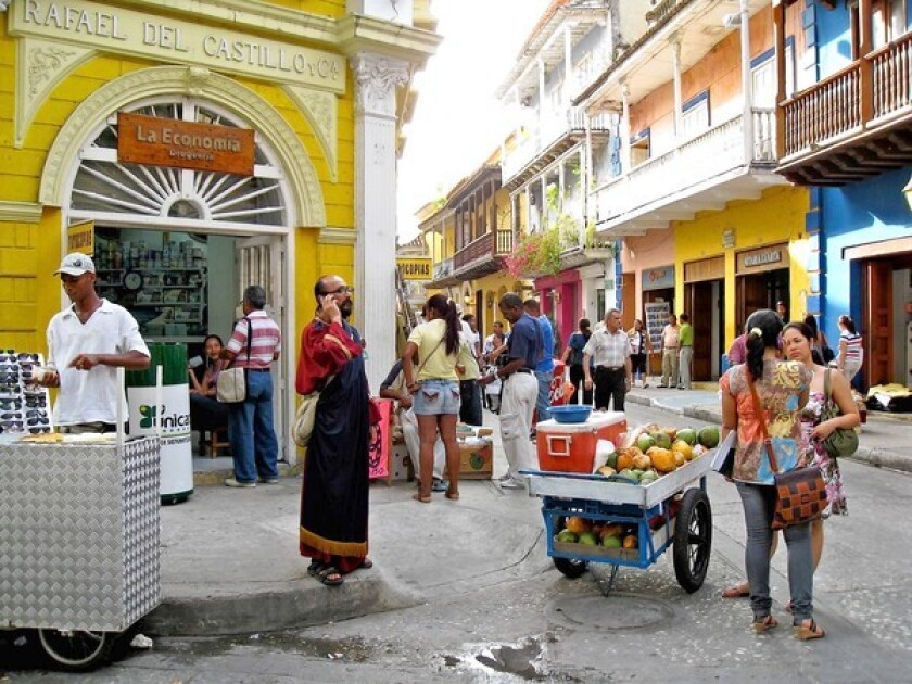 The modern Cartagena, Colombia, of cellphones and pharmacies blends with the colorful past of well-preserved colonial buildings.