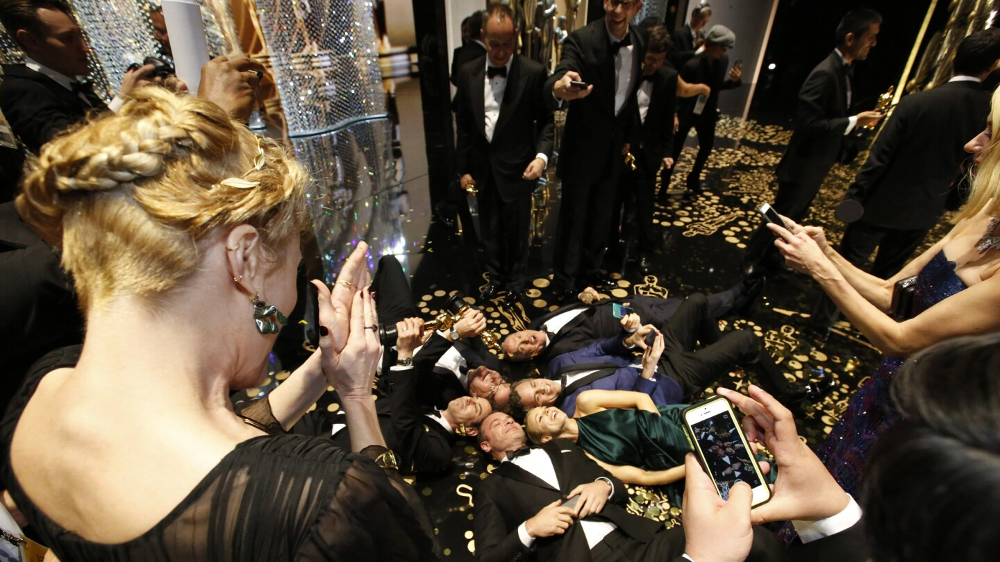 """The cast of Best Picture winner """"Spotlight"""" takes a selfie backstage at the 88th Academy Awards at the Dolby Theatre."""