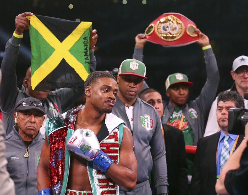 FILE- In this March 16, 2019, file photo, Errol Spence Jr, gestures for a TV camera before an IBF World Welterweight Championship boxing bout against Mikey Garcia in Arlington, Texas. Spence squares off against against Shawn Porter in a IBF/WBC World welterweight title fight on Saturday. (AP Photo/Richard W. Rodriguez, File)