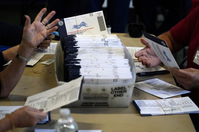 Chester County election workers process mail-in and absentee ballots for the 2020 general election in the United States at West Chester University, Wednesday, Nov. 4, 2020, in West Chester, Pa. (AP Photo/Matt Slocum)