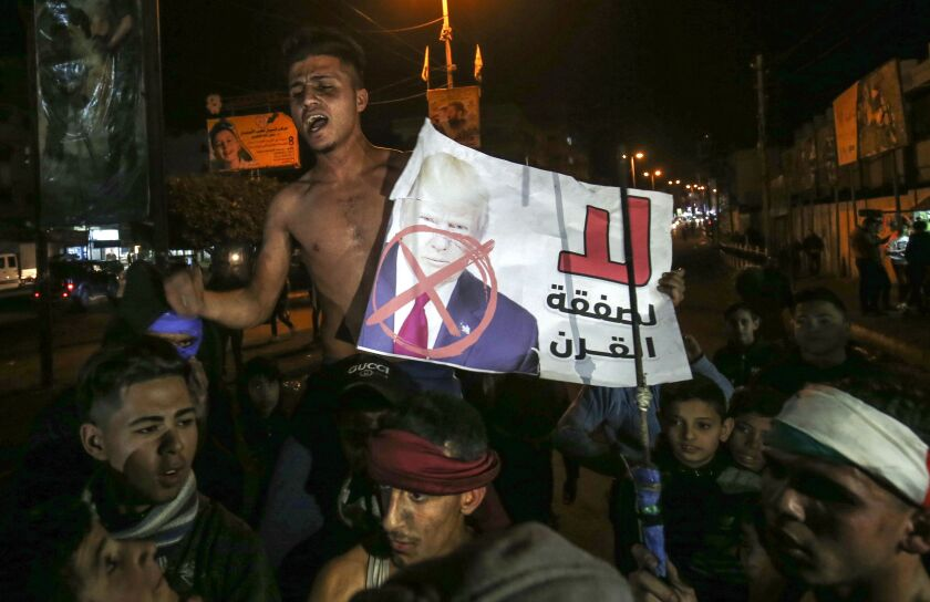 Palestinians in the southern Gaza Strip protest a U.S. peace proposal on Thursday.