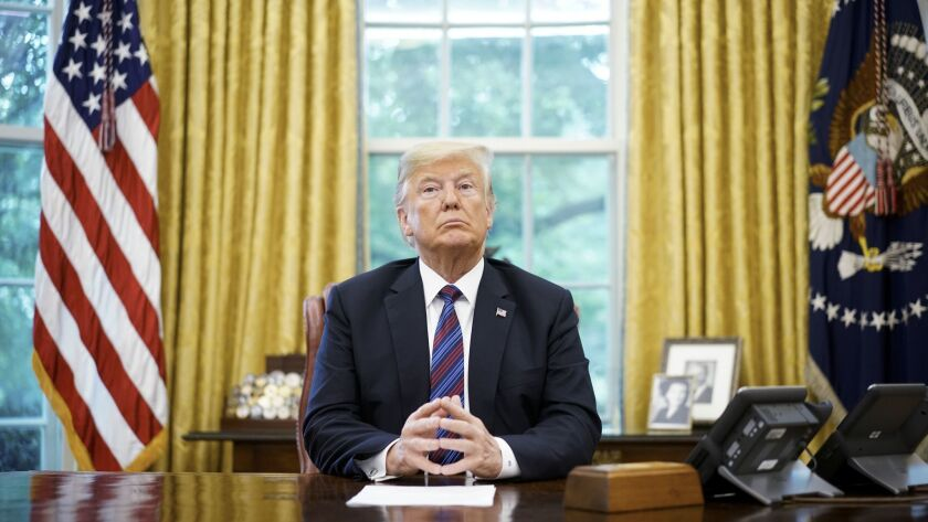 President Trump listens during a phone conversation Aug. 27 with Mexico's President Enrique Pena Nieto on trade in the Oval Office of the White House in Washington, D.C.