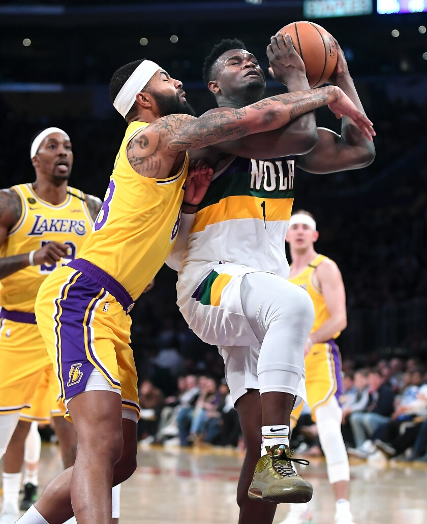 New Orleans Pelicans' Zion Williamson is fouled by Lakers' Markieff Morris while driving to the basket in the fourth quarter at Staples Center on Tuesday.