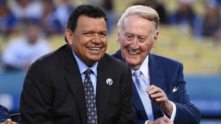 Dodgers legend Fernando Valenzuela, left, jokes with retired Dodgers broadcaster Vin Scully during a pregame ceremony at Dodger Stadium in September.