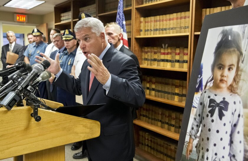 Suffolk District Attorney Daniel Conley speaks to the media on developments in the case of Bella Bond who became known as Baby Doe on Friday, Sept. 18, 2015, in Boston. Conley said that he authorized the murder charge for the boyfriend, Michael McCarthy, and that the mother, Rachelle Bond, was under arrest for accessory to murder after the fact. (Matthew J. Lee/The Boston Globe via AP) BOSTON HERALD OUT, QUINCY OUT; NO SALES; MANDATORY CREDIT