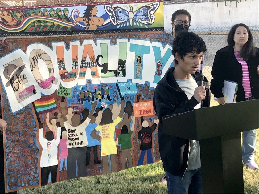 Gabe Estrada, a Placentia-Yorba Linda Unified School District student, speaks at a press conference.