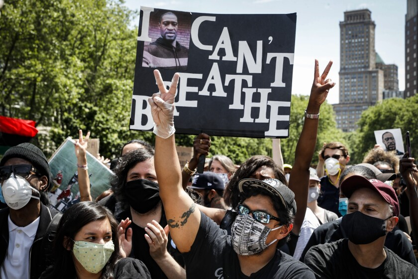 Protesters chant during a rally at Cadman Plaza Park, in New York.