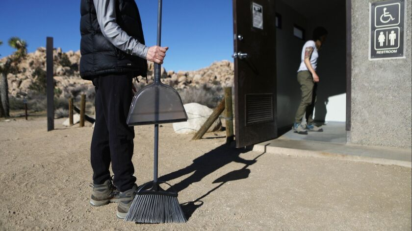 Volunteers prepare to clean a restroom at Joshua Tree National Park on Jan. 4. Campgrounds and some roads have been closed over safety concerns caused by the partial shutdown of the federal government.